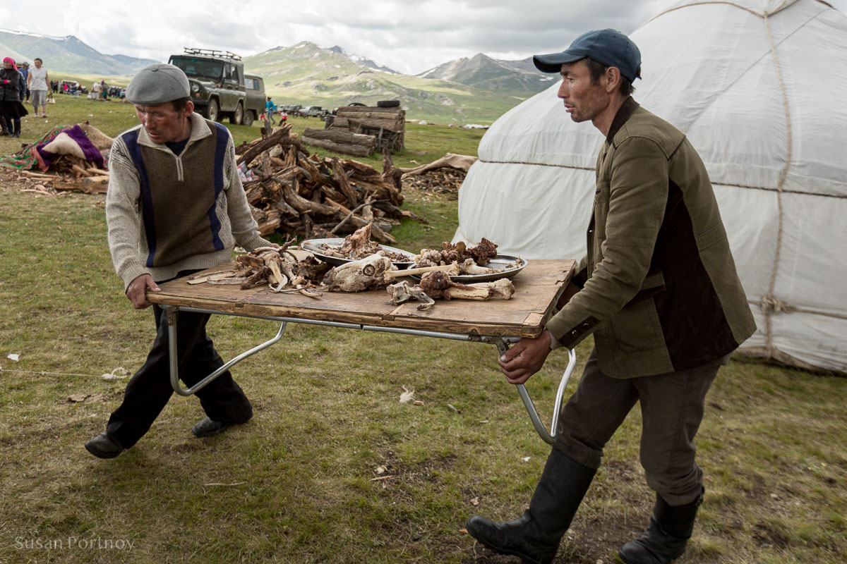 Boiled sheep and goat are classic dishes in Kazakh cuisine served to guests during a Kazakh wedding. Here. remnants, including a sheep's skull, are removed from one of the gers