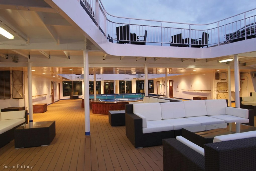 The pool deck on the Safari Endeavor with couches and and chairs for passengers to use