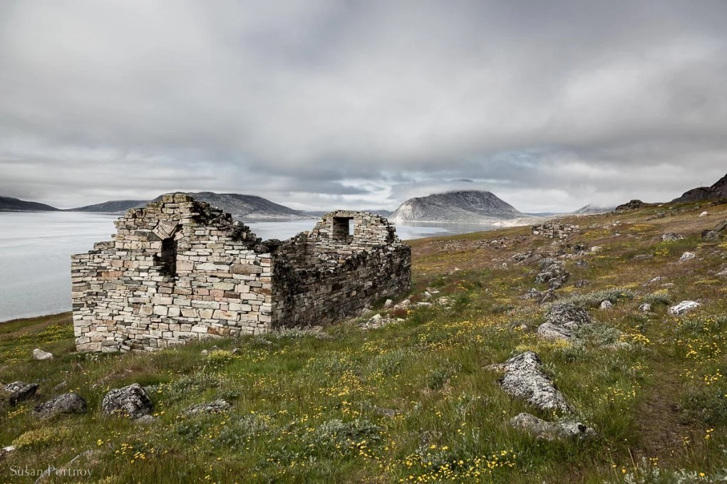 The church ruins at Hvalsey next to the water at the end of a fjord in Greenland.