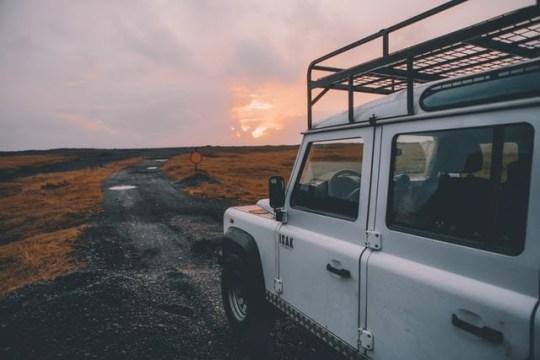 White SUV on black dirt