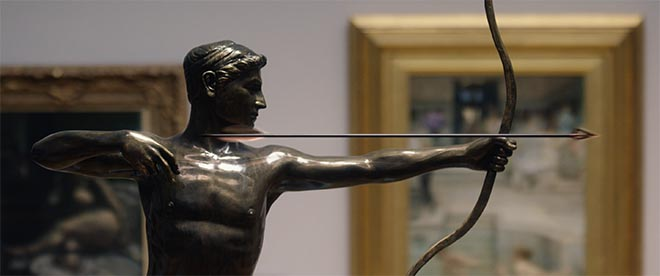 Statue with bow arrow in Galaxy Chase commercial