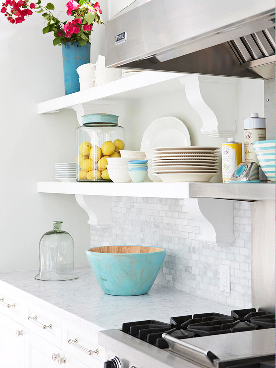 Kitchen Design Essentials White Kitchen with Blue Dishes and Floral Decor on Open Display Shelving