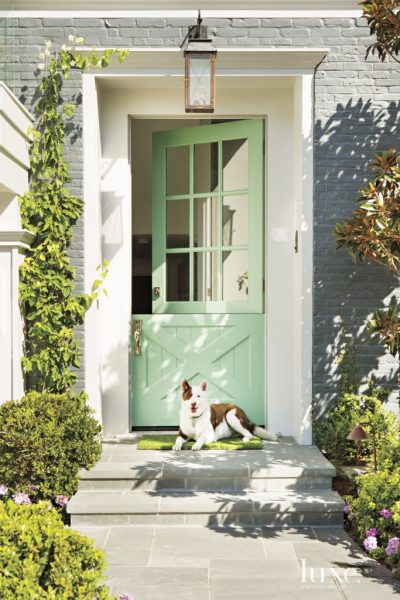 Mint Green Dutch Door - Pretty Gray Painted Brick House