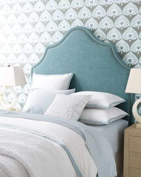 Beautiful bedroom with wallpaper and teal headboard