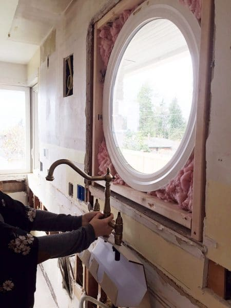 brass-faucet-and-new-round-window