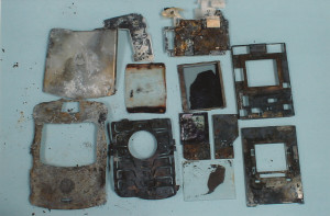 Exhibit-412-Burnt-Cell-Phone-Pieces-1024x674