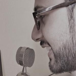 side pic of bijay speaking on mic