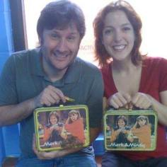 Megan Hayes shows off her collector's item... an original Mork and Mindy tin lunch box.