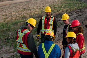 A team meets to discuss reclamation work at Shell's Muskeg River mine in Canada's Athabasca oil sands. Image: IBM/Shell