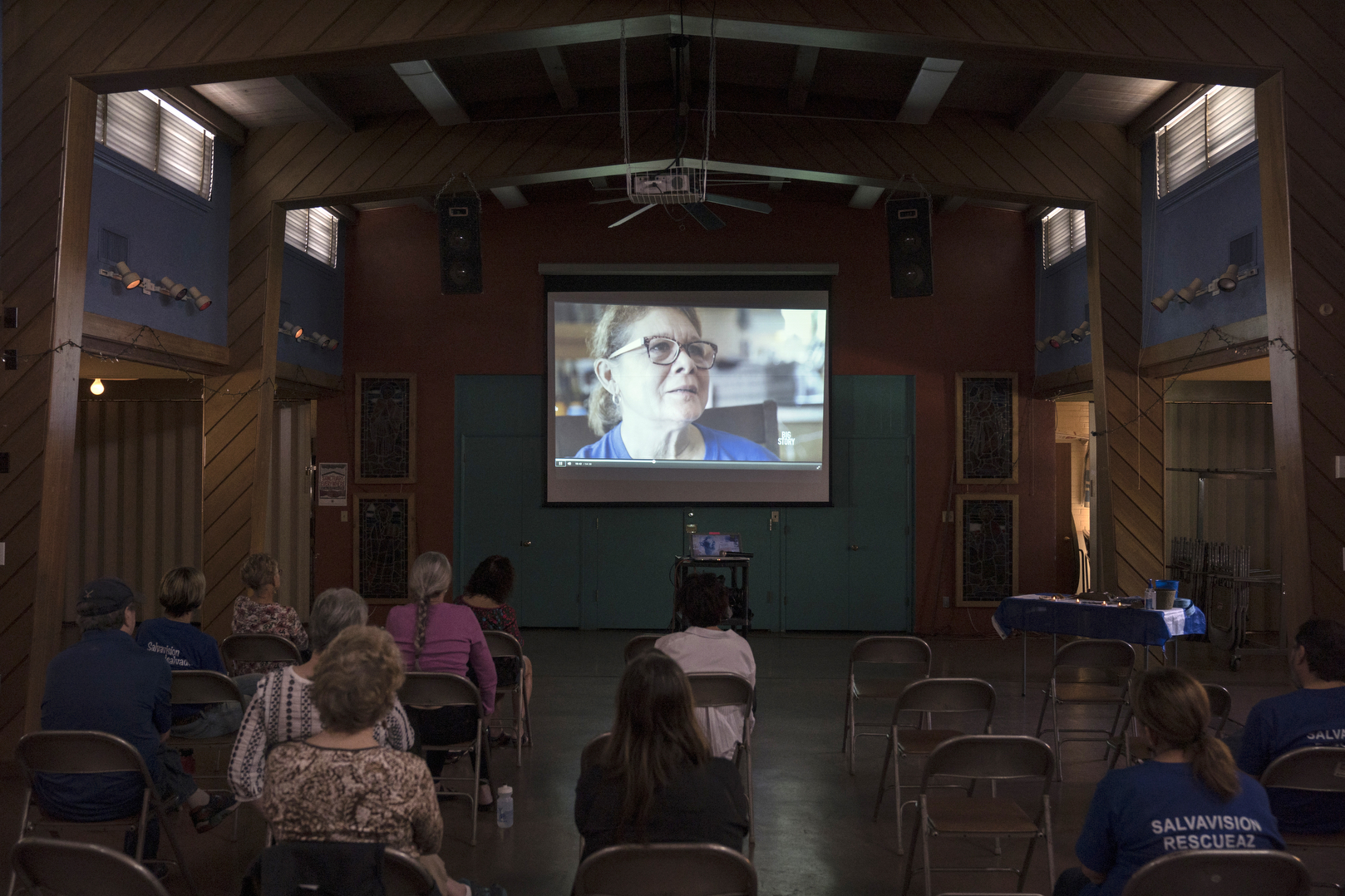 TUCSON, AZ - MARCH 14, 2020: Attendees watch a screening of the documentary film 'Deserted' by filmmaker Jason Motlagh at the Grace St. Paul's Episcopal Church in Tucson, AZ, during a fundraiser to help raise $7000 to cover the bond for a young Salvadoran man currently in ICE detention on March 14, 2020.   In 1980 19-year-old Dora Rodriguez, from El Salvador, made the difficult journey of crossing into the US near Lukeville, AZ on foot. Of the 26 individuals she crossed the Sonoran desert with 13 died in the gruelling heat, one of the pre-eminent events that led to the Sanctuary Movement. Dora eventually naturalised in the US and started an advocacy group, Salvavision Rescue Arizona, to support asylum-seekers. On a weekly basis Dora visits asylum seekers in detention centres, writes them letters, fundraises and brings donated supplies to the migrant camps on the Mexican side of the US - Mexico border.  Photo by Kitra Cahana/MAPS for The Intercept