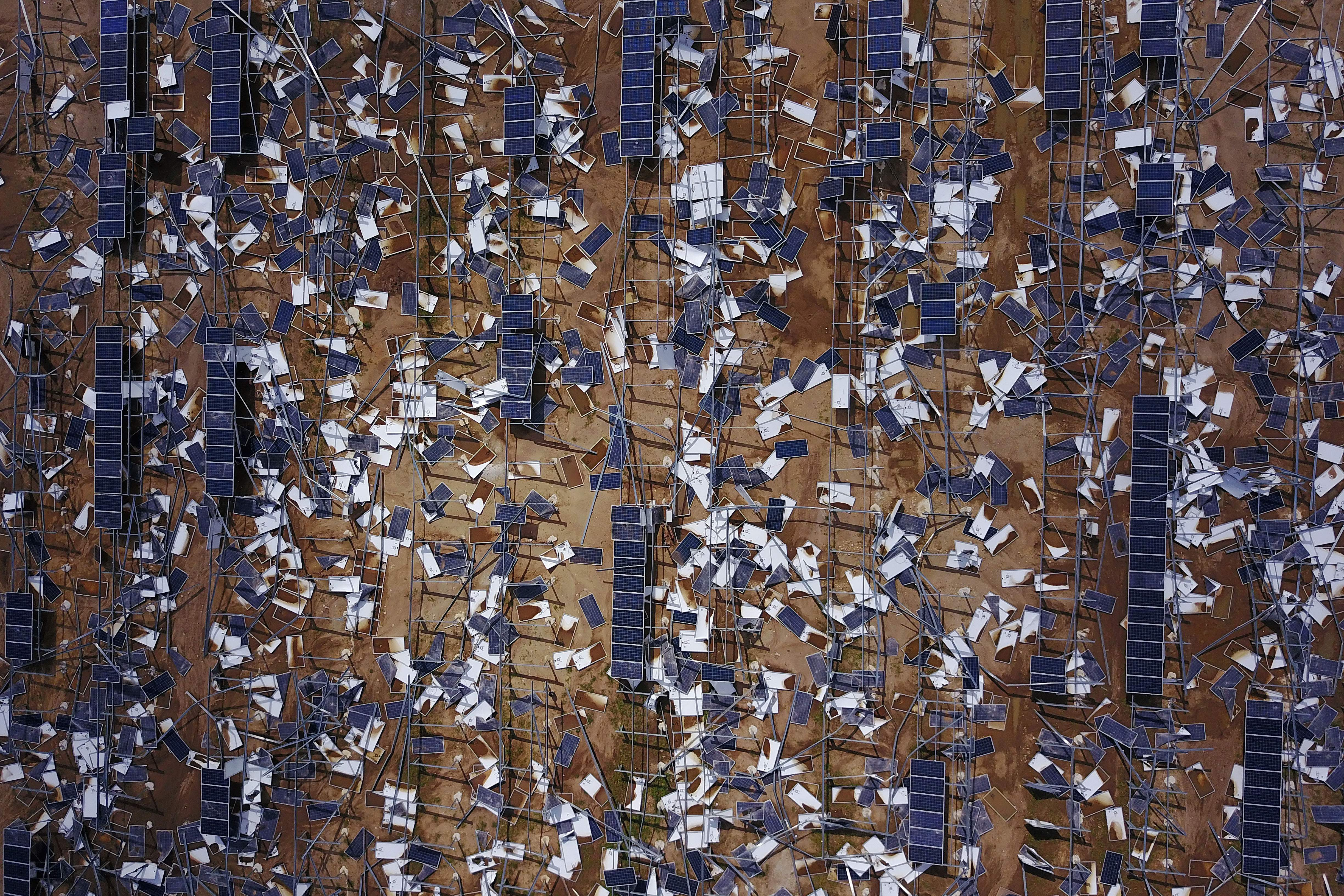 """TOPSHOT - Solar panel debris is seen scattered in a solar panel field in the aftermath of Hurricane Maria in Humacao, Puerto Rico on October 2, 2017. President Donald Trump strenuously defended US efforts to bring relief to storm-battered Puerto Rico, even as one island official said Trump was trying to gloss over """"things that are not going well,"""" two weeks after devastating Hurricane Maria left much of the island without electricity, fresh water or sufficient food. / AFP PHOTO / Ricardo ARDUENGO (Photo credit should read RICARDO ARDUENGO/AFP/Getty Images)"""