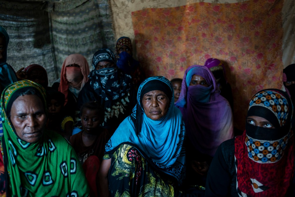 Yemeni women from the Warazan area of Taiz sit in a tent to escape the sun on April 23, 2018 in Mishqafa Camp, Al Fayoush, Yemen. Their families fled from fled from the frontline and because of shortages: they all paid about $100 per person to come by bus in the middle of the night.