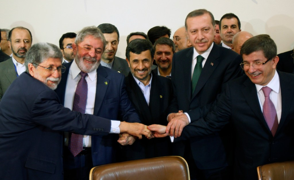 From left to right, Brazilian Foreign Minister Celso Amorim, Brazilian President Luis Inacio Lula da Silva, Iranian President Mahmoud Ahmadinejad, Turkish Prime Minister Recep Tayyip Erdogan, and Turkish Foreign Minister Ahmet Davutoglu, shakes hands before signing an agreement to ship most of Iran's enriched uranium to Turkey in a nuclear fuel swap deal, in Tehran, Iran, Monday, May 17, 2010. Iran agreed Monday to ship most of its enriched uranium to Turkey in a nuclear fuel swap deal that could ease the international standoff over the country's disputed nuclear program, just as pressure mounts for tougher sanctions. (AP Photo/Vahid Salemi)