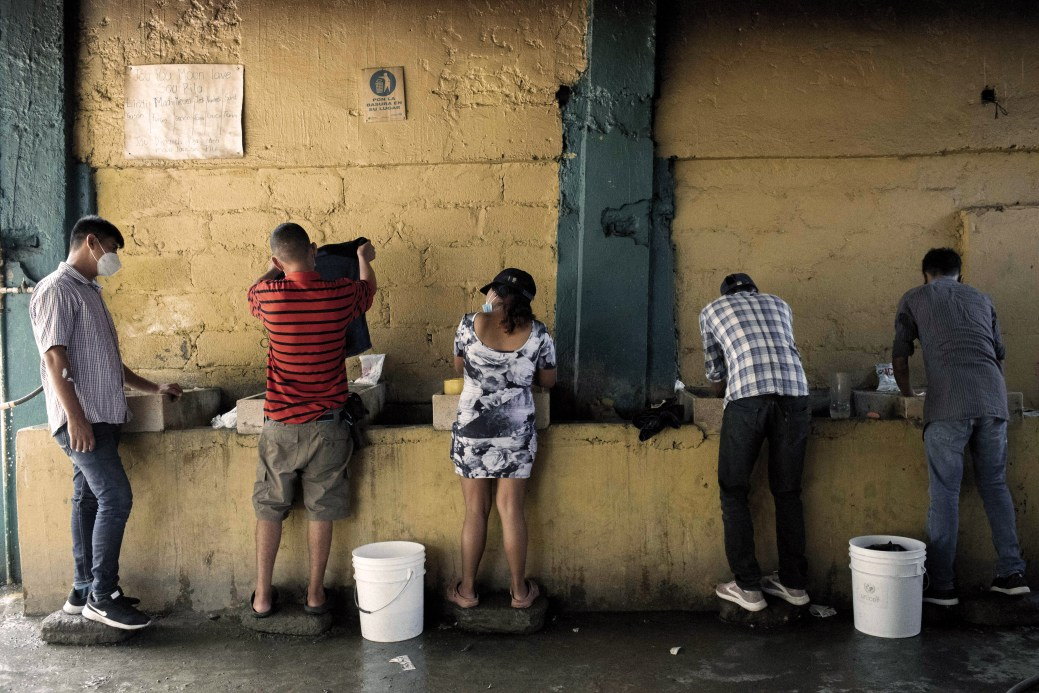 Migrants and asylum seekers wash clothing at a shelter in Tapachula, Chiapas state, Mexico, on Friday, Jan. 29, 2021. U.S. President Joe Biden and Mexican PresidentAndres Manuel Lopez Obrador agreed to work together to stem the flow of irregular migration to their countries, the White House said. Photographer: Nicolo Filippo Rosso/Bloomberg via Getty Images