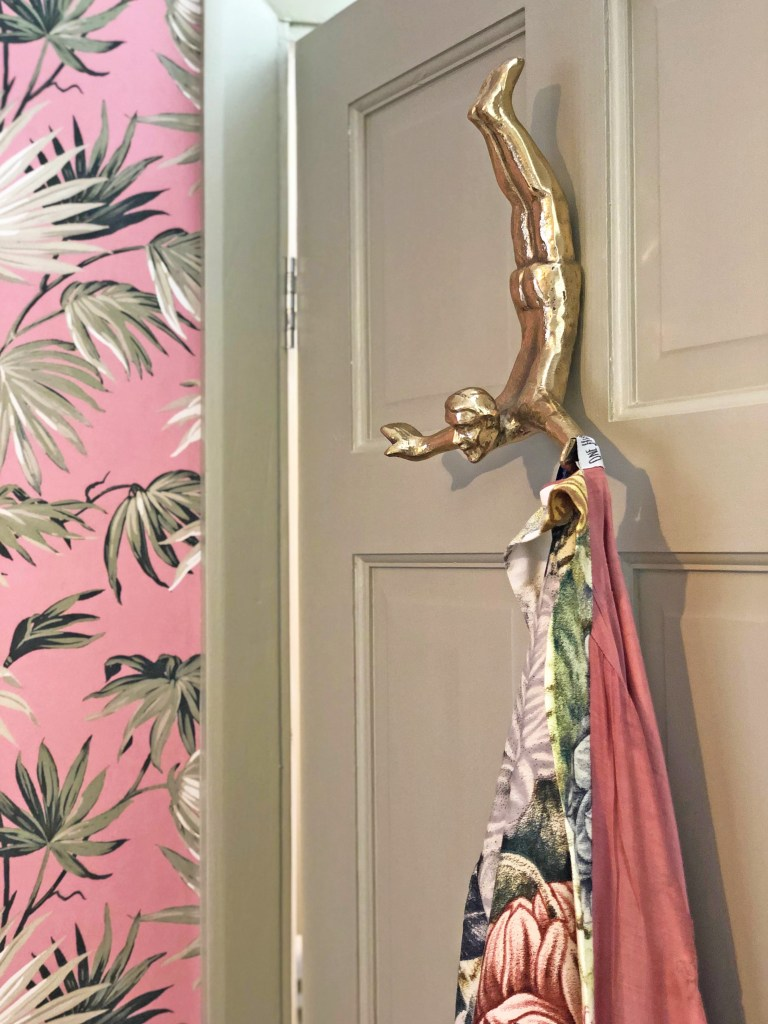 12 Essential Design Tips To Help Update ​Your Home | Solid brass Diving Man Wall Hook from Rockett St George adds a fun element to our bedroom makeover.