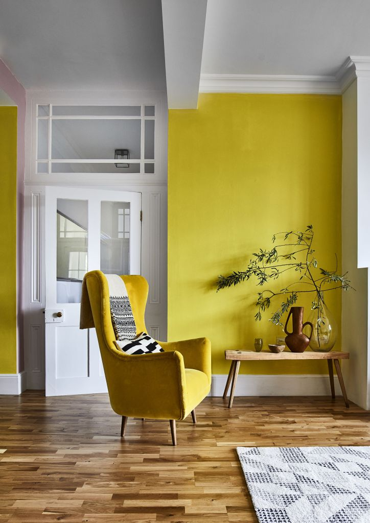 12 Essential Design Tips To Help Update Your Home | Colour blocking adds instant visual interest. This bright and sunny living space benefits from using yellow paintwork to create happy vibes.