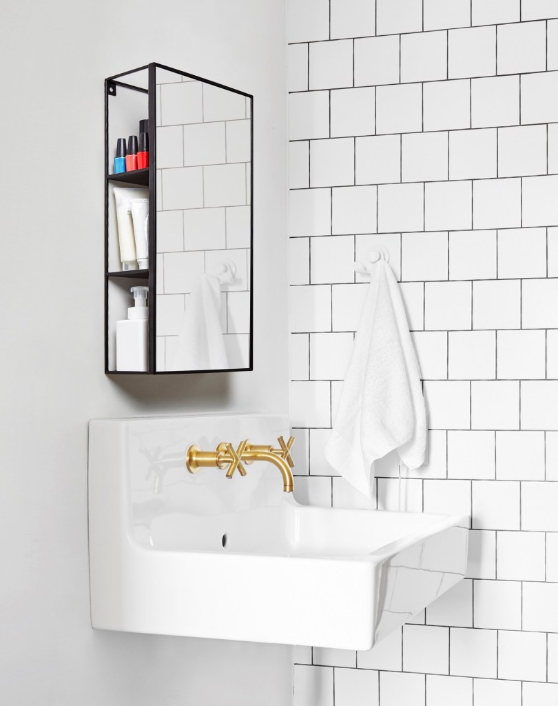 12 Essential Design Tips To Help Update ​Your Home | Storage is key to keeping your homes clutter free. Invest in multifunctional pieces such as this Umbra Cubiko Wall Mirror and Storage Unit for your bathrooms will help.