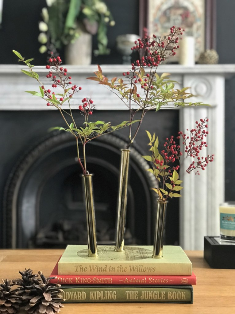 12 Essential Design Tips To Help Update Your Home | Books are brilliant for vignettes and coffee table decor. Here books are styled with STEM vases from Anthology Five.