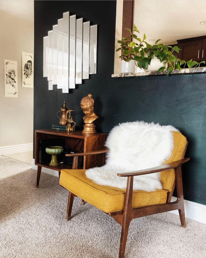 An Eclectic '70s Home Filled With Vintage Finds - Jenasie Earl | Styled living room with vintage furniture and accessories add interest and character to this eclectic home.