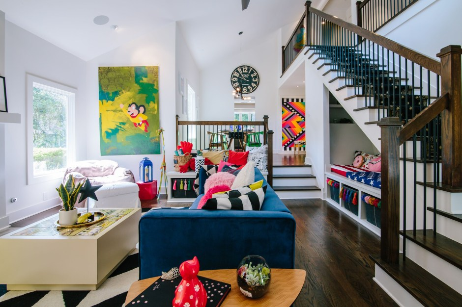 The Creative, Bold & Colourful Home of Paola Roder - double height ceilings to this open plan split level living room creates an abundance of natural light that makes it feel spacious and sets the perfect backdrop to art, vibrant colour palette and bold pattern decor.
