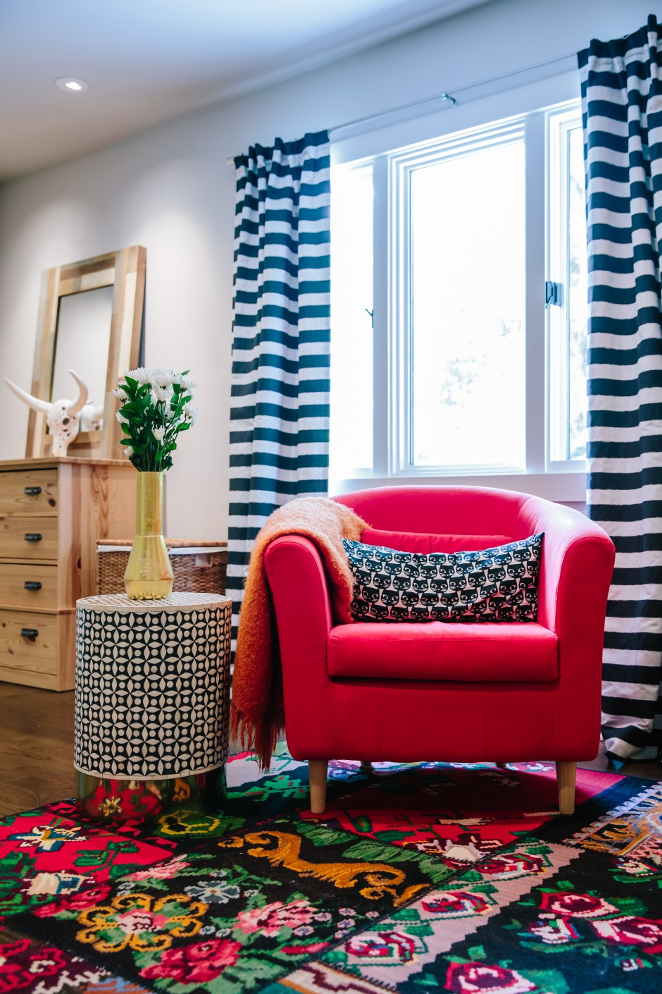 The Creative, Bold & Colourful Home of Paola Roder | Bold colourful bedroom seating area showing how to use pattern on pattern to great effect.