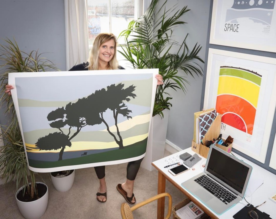 Karina Mansfield - Minimalist Pop Art For Your Homes | Karina Mansfield in her studio with a landscape design
