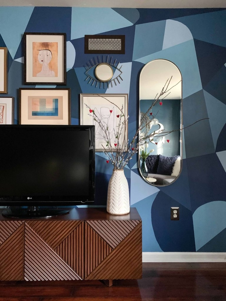 How To Use Paint Creatively In Your Home | handpainted shapes wall mural by Mel to her living room