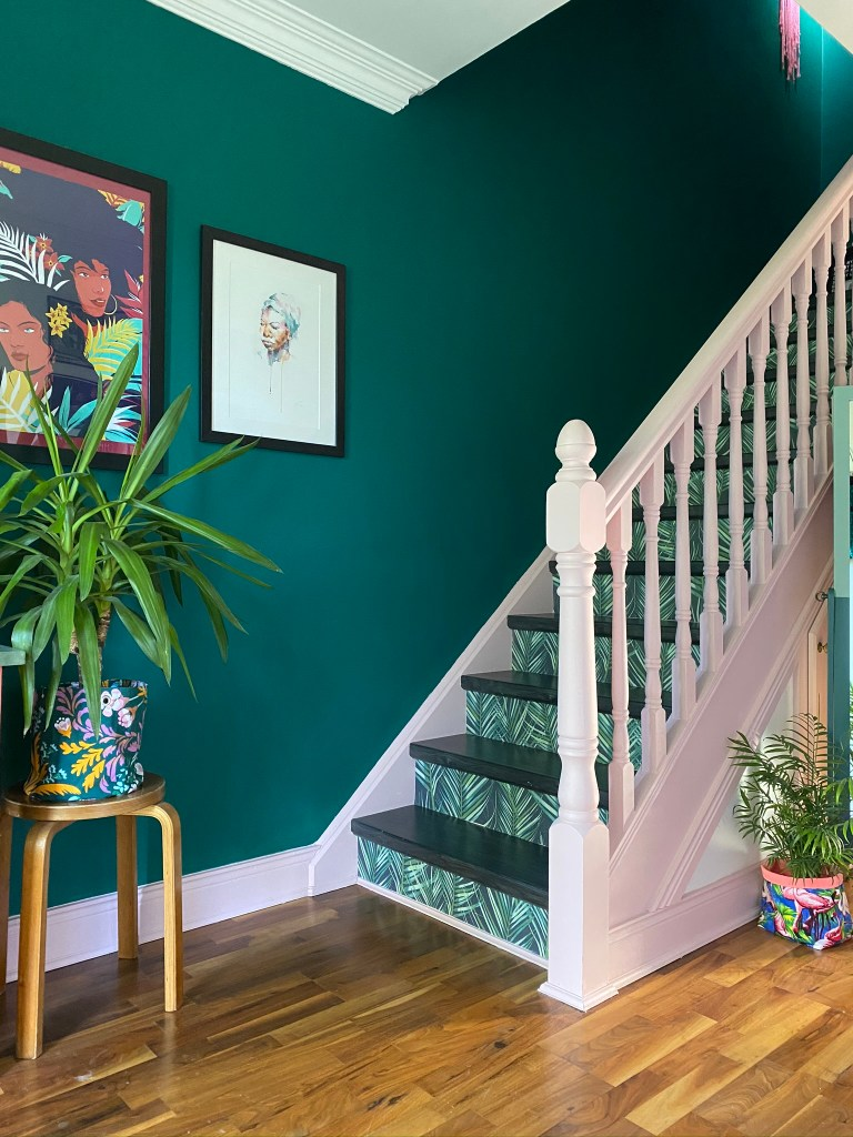 Bold botanical wallpaper on the stairs with bold pink and green paintwork to create a statement stairs and entrance| Colour & Pattern Filled Eclectic Home - Saara McLoughlin