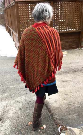 Rear view double faced machine knit poncho