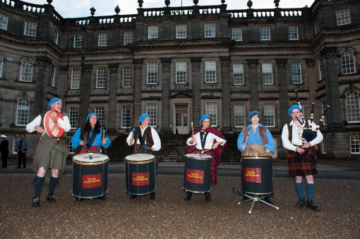 Traditiontal Band greet Guests as they arrive to Hopetoun Estate