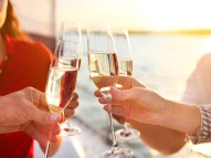 Happy friends with glasses of champagne on yacht. Vacation, trav