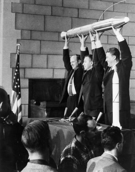 Dr. William H. Pickering, Dr. James A. van Allen, & Dr. Wernher von Braun hold a model of the Explorer I satellite which launched 4 months after Sputnik - 1958