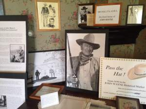 As you walk in to the Manatt House you're greeted by the Brooklyn, IA Historical Society president, Steve Rhodes. And then your attention is directed to the exhibit that is raising money to honor The Duke's boyhood home of 717 Jackson Street. The John Wayne trail starts at his birthplace, in Winterset, IA and then takes a path to Brooklyn, IA then to Earlham, IA, back to Brooklyn and then to California. This is the absolute essence of the a towns niche and Brooklyn couldn't be more proud to make John Wayne always feel welcome in his hometown.   https://www.facebook.com/BrooklynHistoricalSociety?fref=ts
