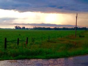 The sun breaking through the clouds on an early Eldora, IA morning.
