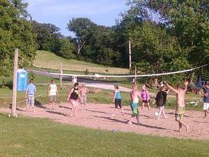 The Rock-N-Row campsite came alive with jubilant campers fresh from their tubing on the river. The sandy volleyball court was a popular site for last few hours of daylight.