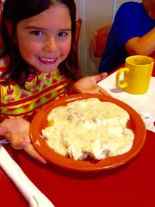 Leah holding up a delicious masterpiece of masterpieces. Biscuits and Gravy from the Classic Deli in Brooklyn, IA. https://www.facebook.com/TheClassicDeliIceCreamShoppe?fref=ts