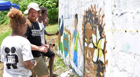 Oxfam trains young artists on graffiti