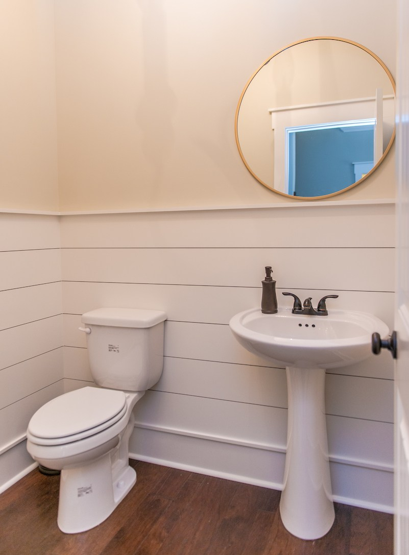 Powder room with shiplap wainscoting