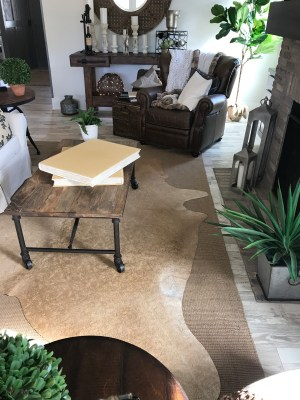 cow-hide-rug-with-leather-chair