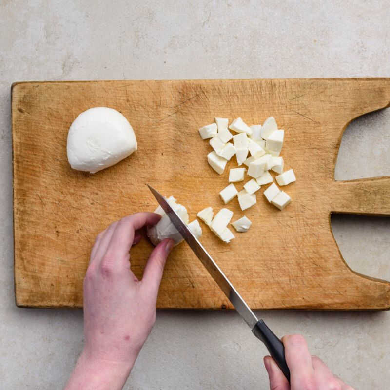 To make frittata recipe, one of the popular italian recipes, cut the fresh mozzarella into 1 cm cubes
