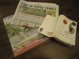 Read newspapers in the mornings and wait to return to books at night.