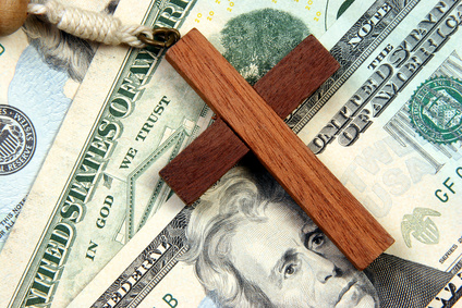 Cross-laying-on-Money-Fotolia_450504_XS