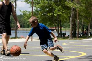 W playing basketball