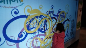 Spray painting the walls at Golisano Children's Museum