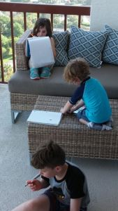 Homeschooling on the balcony at Naples Grande