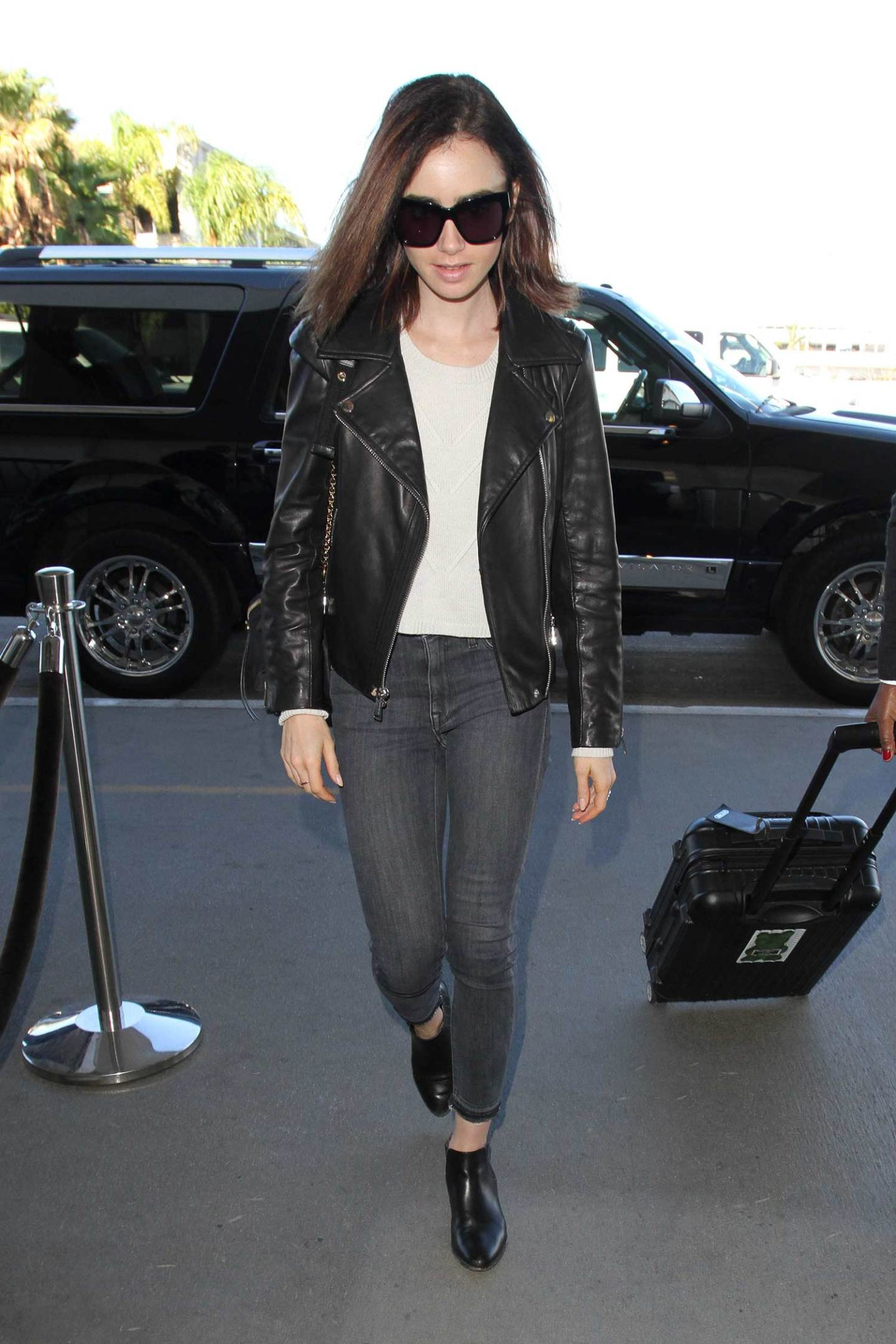 lily-collins-parker-smith-jeans-leather-jacket