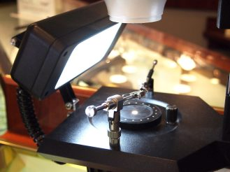 Microscope on showroom floor allows customers to see magnification of unique qualities of a diamond