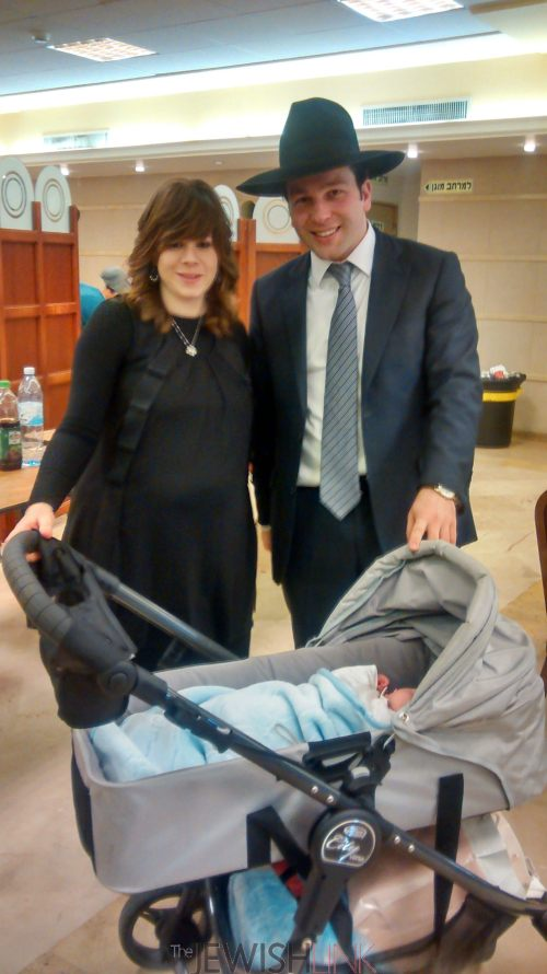 Photo Credit: Anav Silverman, Tazpit News Agency / Dov and Shula Sorotzkin with newborn son following his brit mila ceremony on Wednesday at the Har Nof synagogue where the deadly attack took place on Nov. 18.