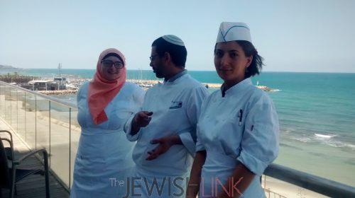 : Culinary students, Roaa Msarwa and Alina Khalaman with their teacher, Oneg Etz Chaim (center) at the Tel Aviv Hilton Hotel.