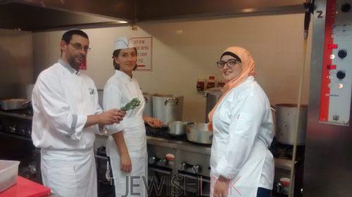 Culinary students, Roaa Msarwa and Alina Khalaman with their teacher, Oneg Etz Chaim (center) at the Tel Aviv Hilton Hotel.